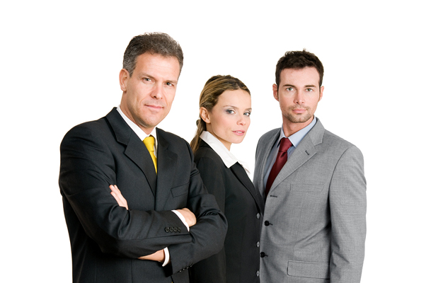 Business team with mature businessman leading the group isolated